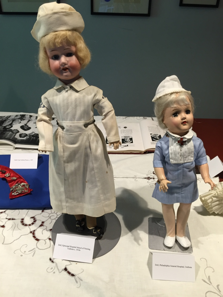 two dolls dressed as nurses