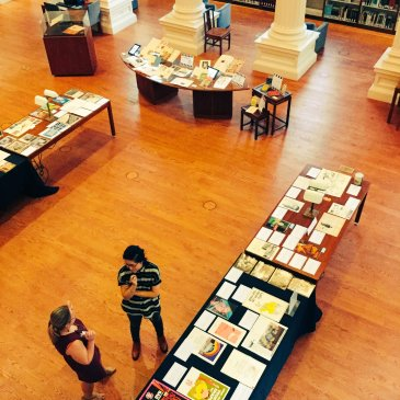 birds-eye view of documents on display