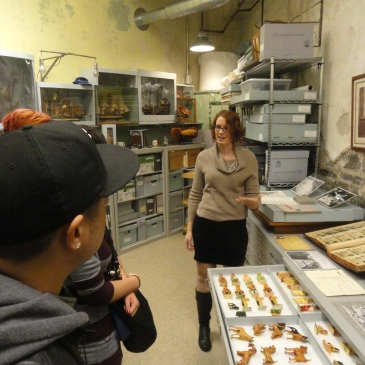 Erica Harman shows visitors toys made by prisoners