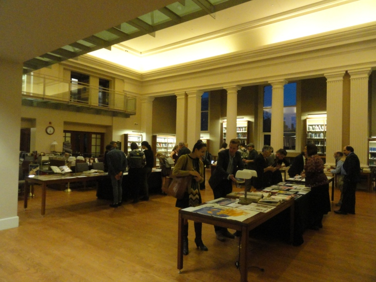 visitors looking at tables full of vintage ads at the Othmer Library