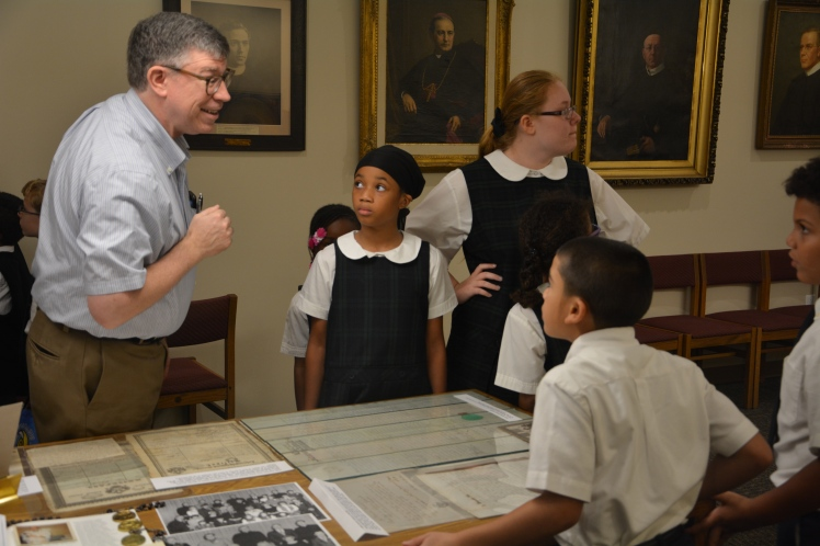 Students looking at documents at the Redemptorist Archives