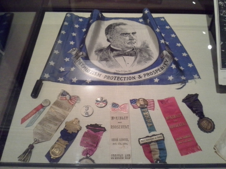 display of McKinley and Roosevelt campaign buttons and ribbons