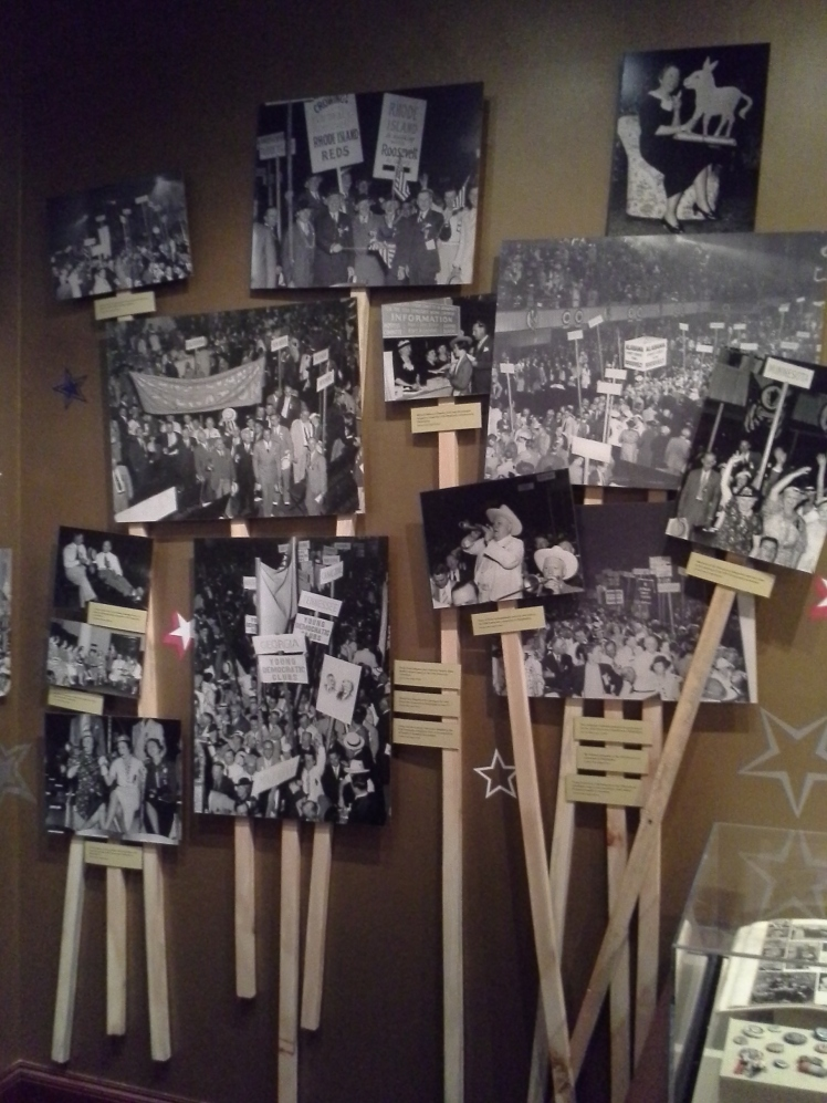display of black and white campaign rally photographs