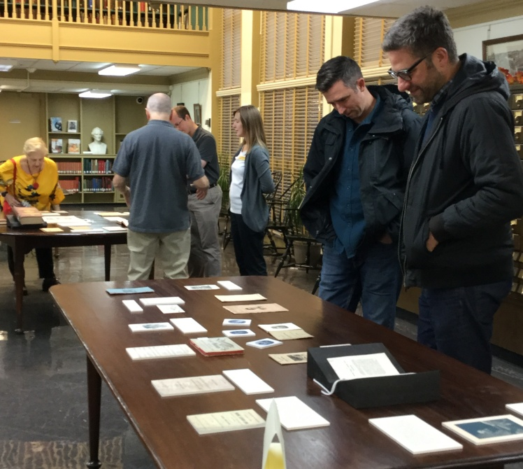 Event attendees viewing materials laid out on tables in the PHS reading room.