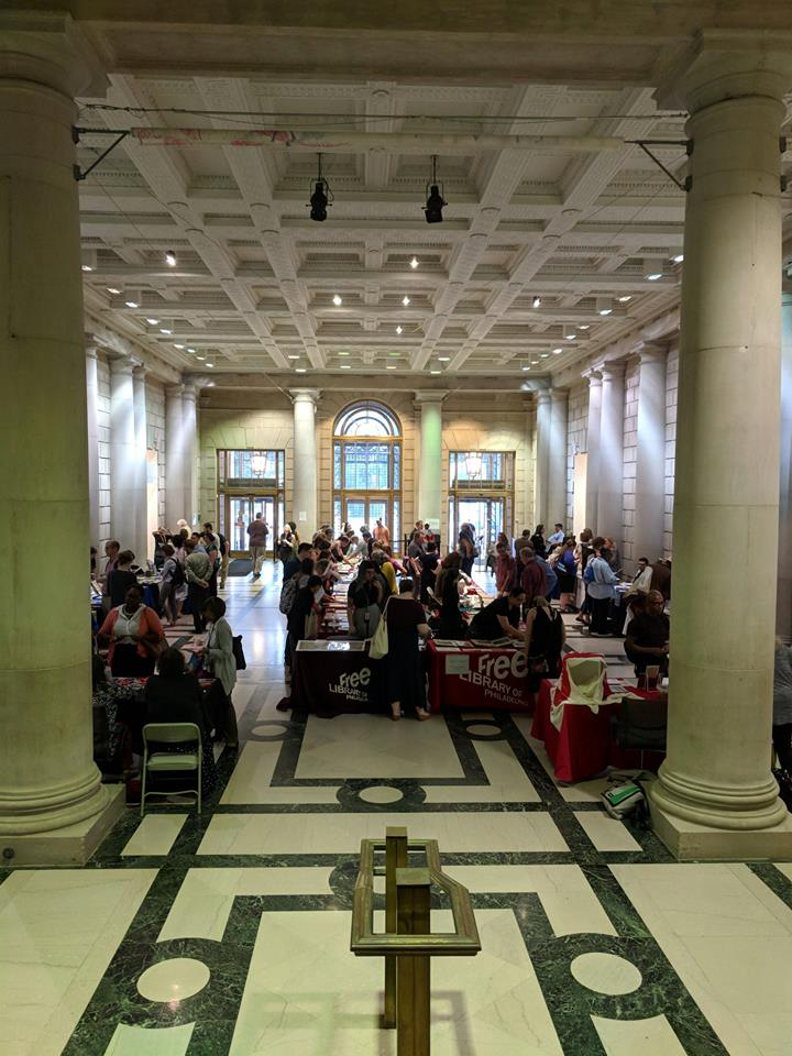 Attendees gathered and mingling in the atrium of the Free Library of Philadelphia.